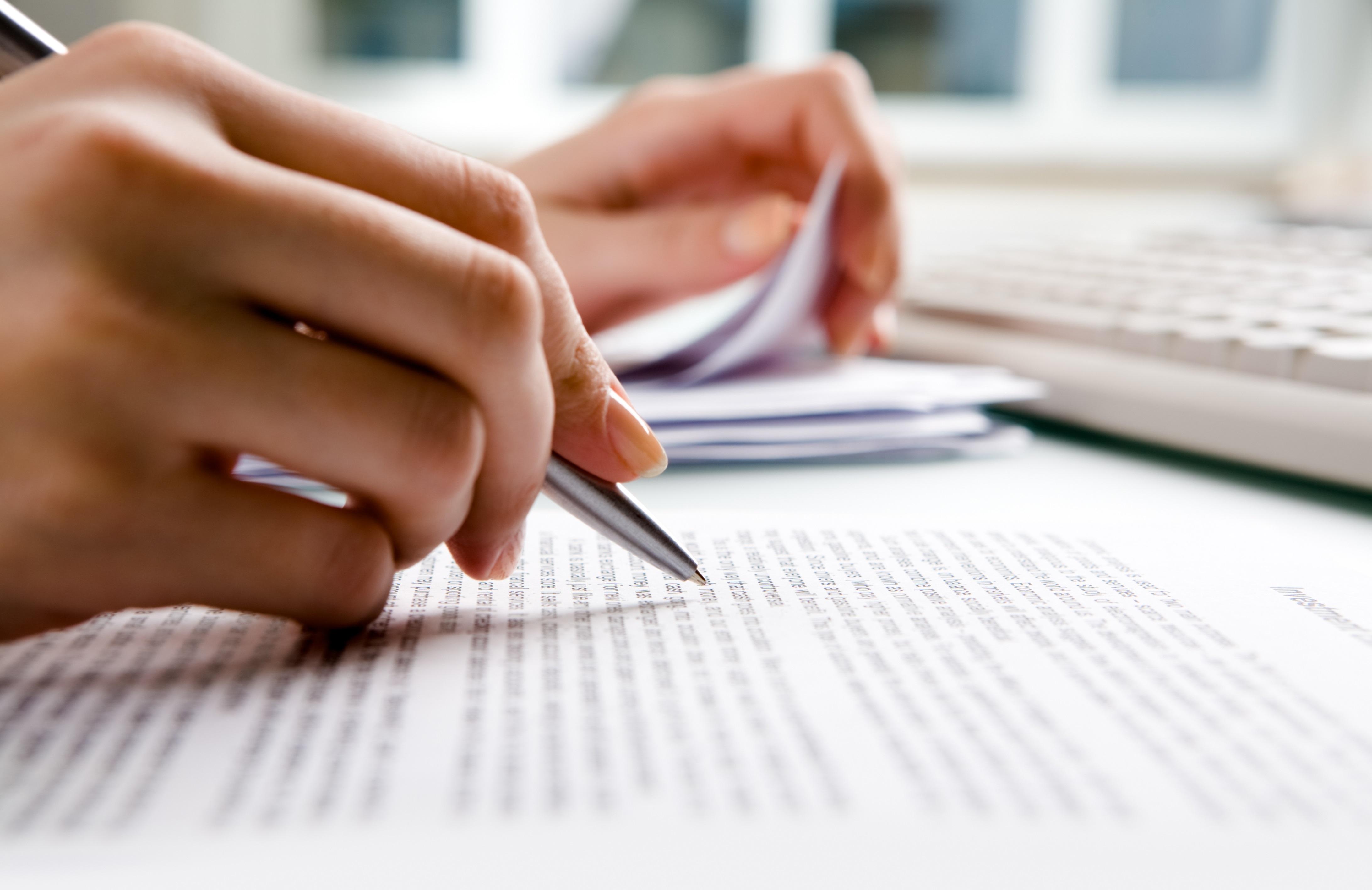 Close-up of secretary's hands doing paperwork